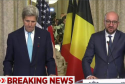Kerry arrives in Brussels to pay respects