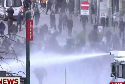 Police fire water cannons at right-wing...