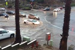 Lamborghini rips through flooded street in CA