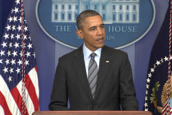 Obama issues a stern warning to Russia
