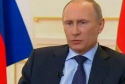 'Combative' Putin speaks of Ukraine 'coup'