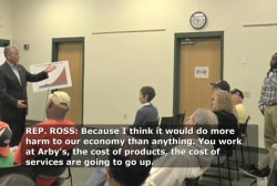 Low-wage worker confronts GOP congressman