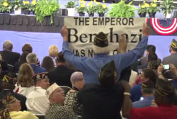 Protester's sign ripped away at Obama speech