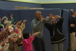 Obama tries out a native Alaskan dance