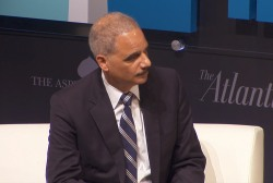 Holder heckled on whistleblower controversy