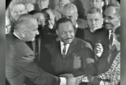 President Johnson signs the VRA into law