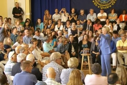 Clinton confronted by climate protesters