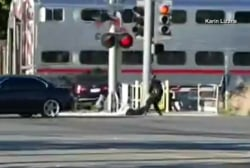 CA police rescue man from oncoming train