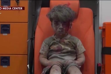 Stark image shows boy pulled from Syrian...