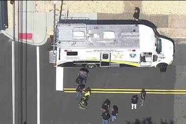 Suspect in custody, en route to hospital