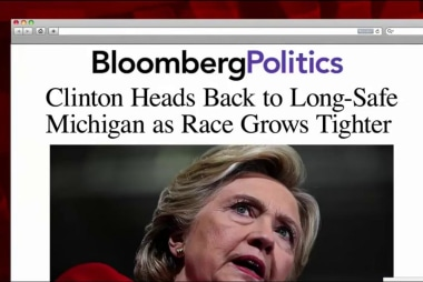 Clinton travels to Mich. as polling tightens