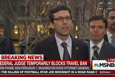 Federal judge temporarily blocks travel ban