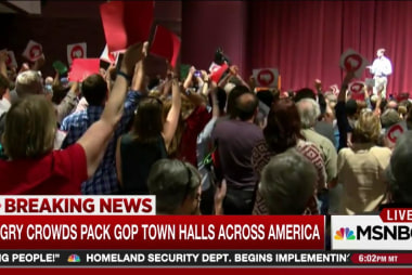 Angry town hall crowds confront GOP