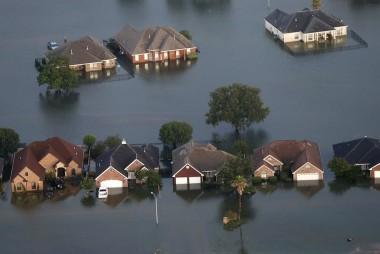 Man surveys Harvey damage, fords flooded...