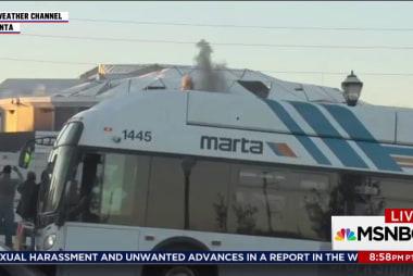Atlanta city bus blocks view of imploding...