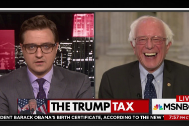 Bernie Sanders laughs at the president
