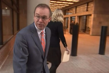 Mulvaney reports for work as lawsuit...