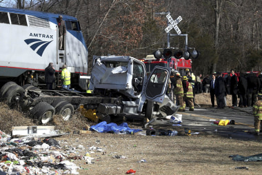 One dead in crash between GOP train and trash truck