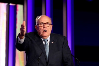 What is Giuliani's strategy for defending Trump?