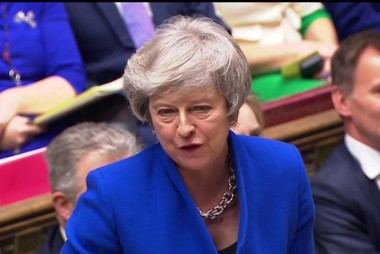 Theresa May survives no-confidence vote as Brexit struggles on