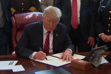 Trump signs veto, twists border facts
