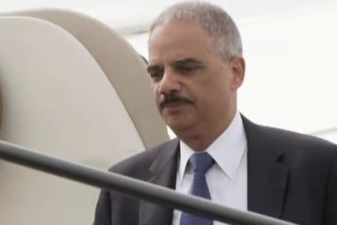 Eric Holder on the ground in Ferguson