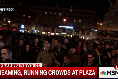 Screaming, running crowds at Paris plaza