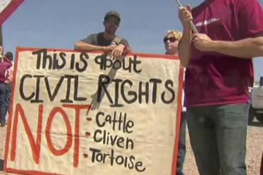 Armed protesters ask people to join standoff
