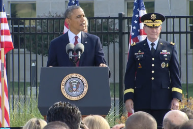 Obama, nation remembers 9/11, contemplates...