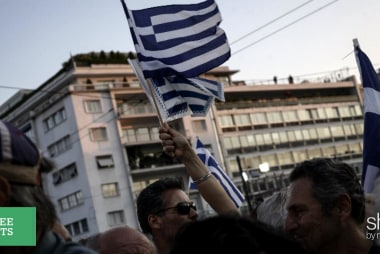 Greece gives in to its creditors