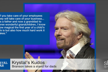 Richard Branson stands with dads