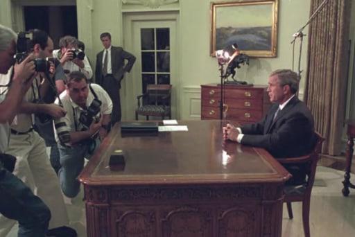 Photos shows Bush's reaction to the 9/11...