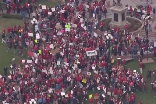 Thousands of teachers walk out in Arizona, Colorado
