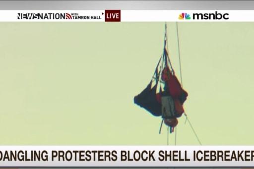 Dangling protesters block Shell icebreaker