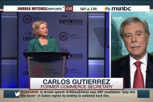Clinton touts progress in call to end embargo