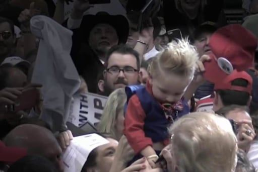 Donald Trump signs a baby