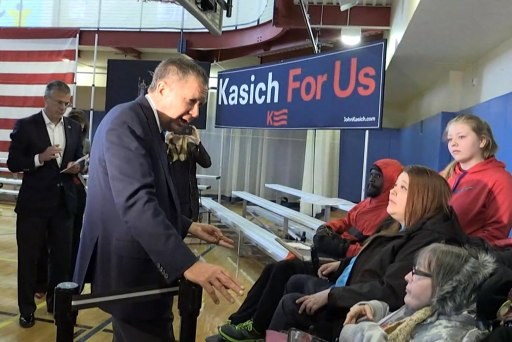 Kasich comes face-to-face with disabled...