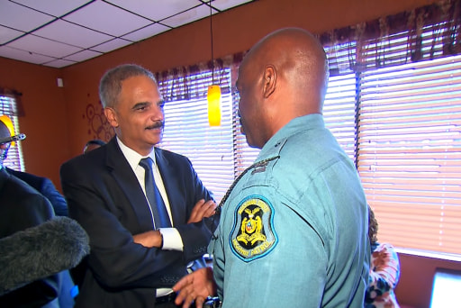 Holder eyes Ferguson police for reform