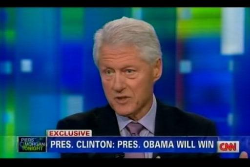 Bill Clinton defends Mitt Romney's...