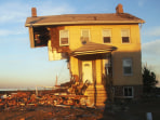 Image: The iconic Princess Cottage, built in 1855, remains standing after being ravaged by flooding on November 21, 2012 in Union Beach, New Jersey.