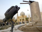 A STATUE OF PRESIDENT SADDAM HUSSEIN FALLS IN CENTRAL BAGHDAD