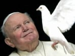 File photo of Pope John Paul II observing a white dove released by children at the Vatican