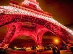 Base of the Eiffel Tower in Red Light