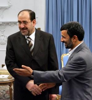 Iranian President Mahmoud Ahmadinejad welcomes Iraq's Prime Minister Nuri al-Maliki in Tehran