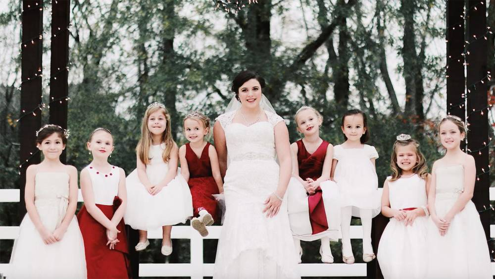 053e228fb78 Baby sitter bride has 15 of her charges in her wedding