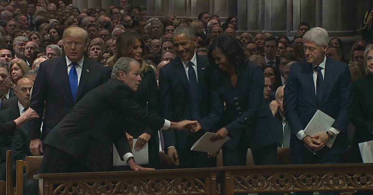 Watch George W. Bush hand Michelle Obama candy again at father's funeral