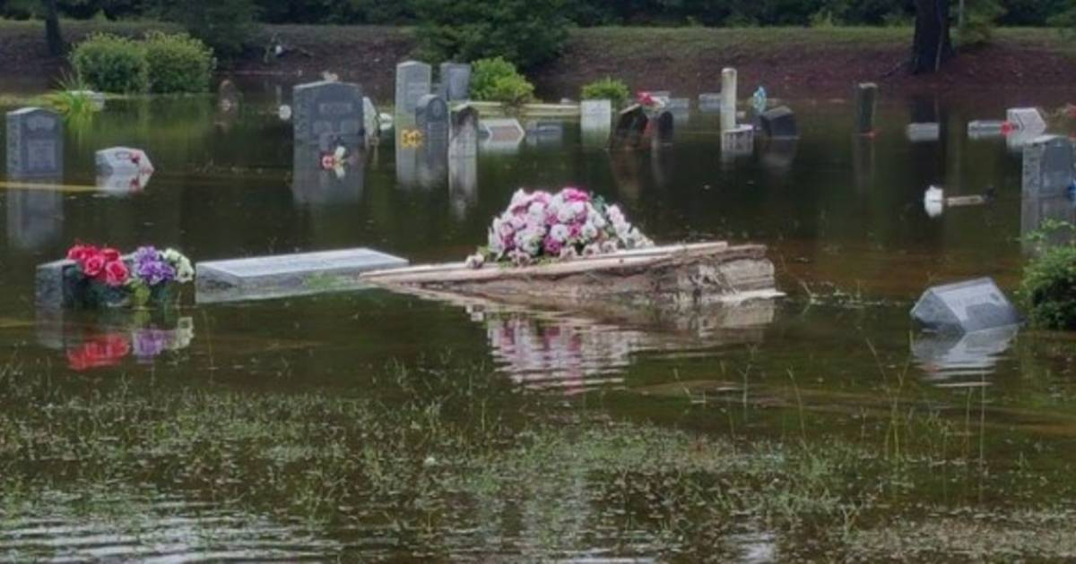 s c pastor braves floodwaters to save casket for grieving family