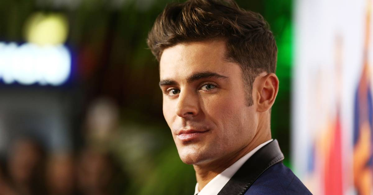 Zac Efron Has A Mustache At 'The Greatest Showman' Premiere