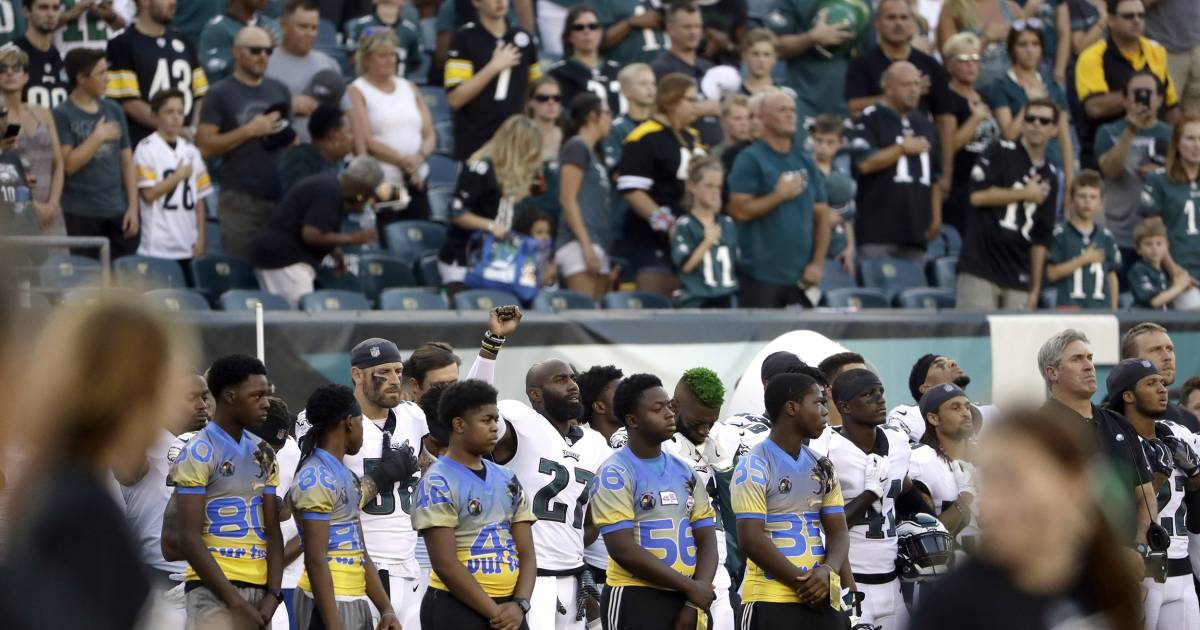 Some NFL players kneel or raise fists during anthem before preseason games