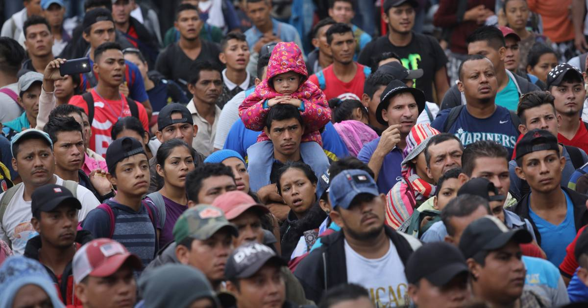 Migrants cross into Mexico, testing President Trump's red line